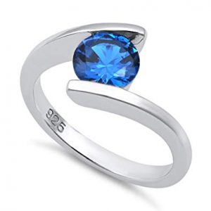 Tension ring with sapphire in sterling silver