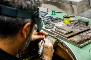 Bespoke Jewellery Design with craftsmen in workshop